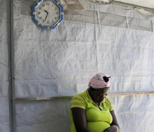 A woman suspected of having cholera waits to be evaluated at a cholera treatment centre run by Medecins Sans Frontieres (Doctors Without Borders) in Port-au-Prince October 21, 2011. REUTERS/Swoan Parker