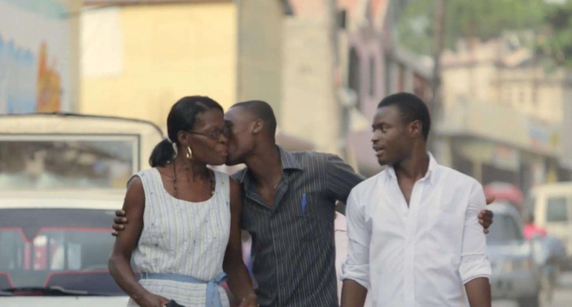 Woman Kisses Son
