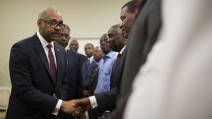 Haiti's newly nominated Prime Minister Dr. Jack Guy Lafontant greets Senate members after his speech at the national palace during the ceremony of his nomination as new prime minister in Port-au-Prince, Haiti. Friday Feb. 24, 2017. President Jovenel Moise announced in a late Wednesday tweet that he and Haiti's two legislative leaders have agreed upon the nomination of Dr. Jack Guy Lafontant. Lafontant is a gastroenterologist and head of the Rotary Club in the commercial district of Petionville. Both houses of parliament will vote on whether to confirm Lafontant after he presents a plan of government.( AP Photo/Dieu Nalio Chery)